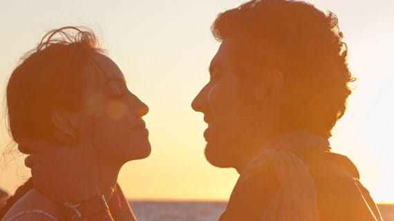 Couple looking at each other at sunset